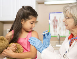 Young Hispanic girl gets a flu shot