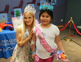 Miss L.A. County delivers 1000 toys to patients