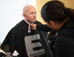 man getting beard shaved
