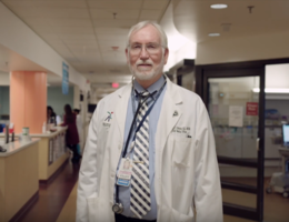 older white male standing in hospital setting