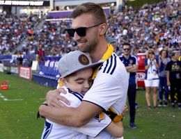Seth Akins, 11, of Rancho Cucamonga, greets his bone marrow donor, Aaron Allen 23, of Long Beach, for the first time during halftime at the LA Galaxy game on Sunday, Sept. 23.