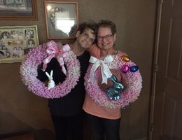 Two women holding easter wreaths