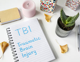 note book that has traumatic brain injury written