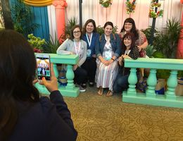 Conference attendees enjoyed bright, floral photo opportunities with friends.