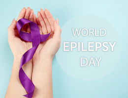 hands with purple ribbon honor world epilepsy awareness day