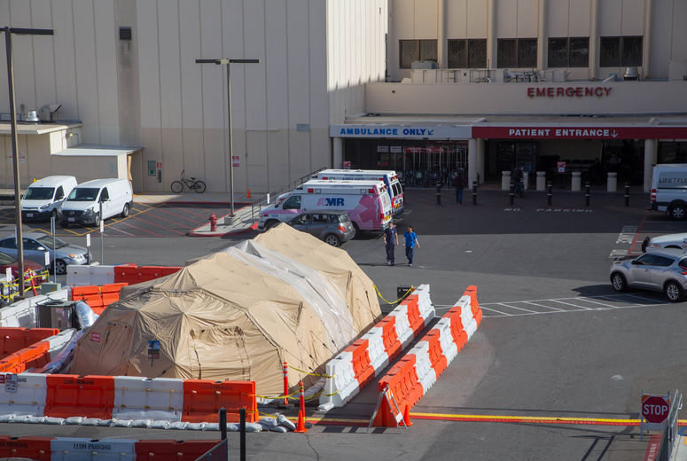 flu tent in front of emergency room