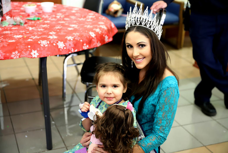pageant queen poses with young female patient