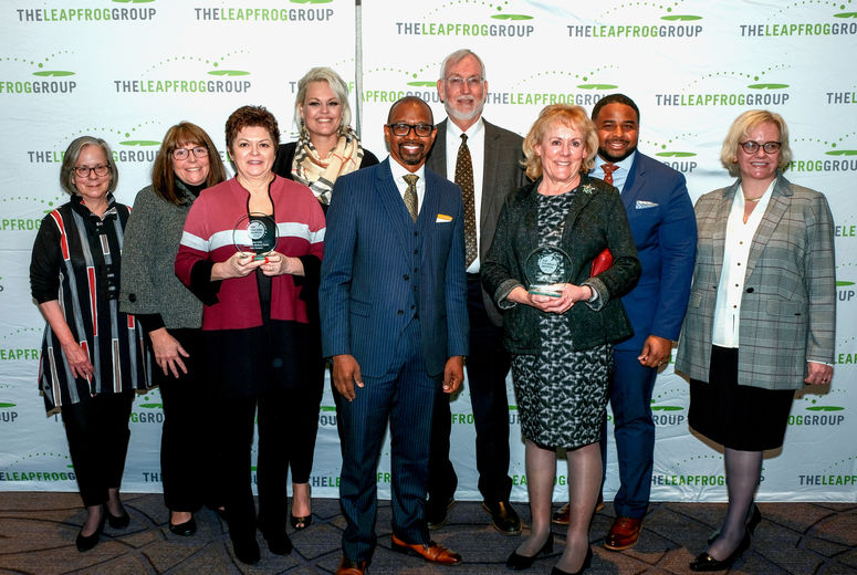 administration take photo with leapfrog award