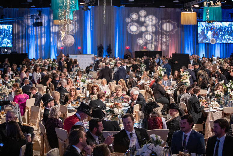 large decorate gala room full of people at tables