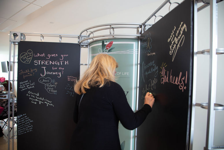 Woman writing on a chalkboard