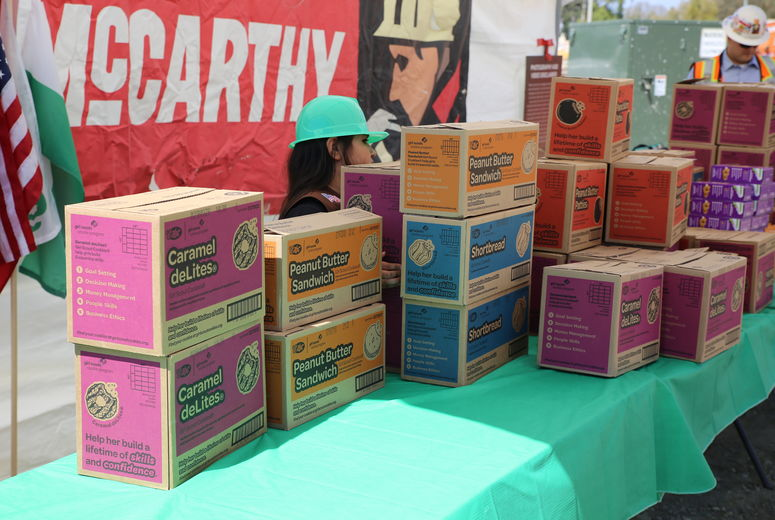 boxes of girl scout cookies stacked on table