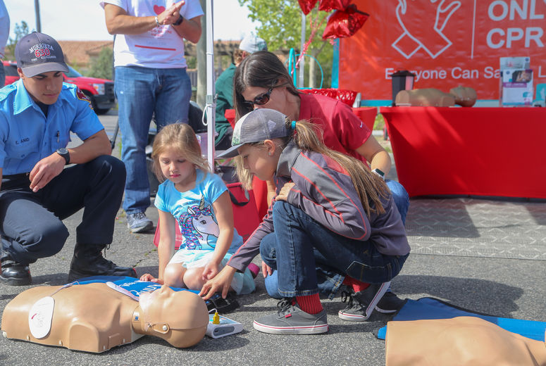 Young Children learn CPR from first responders