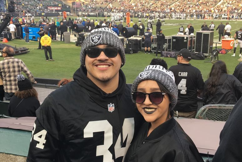Melendrez and her brother at a Raiders game
