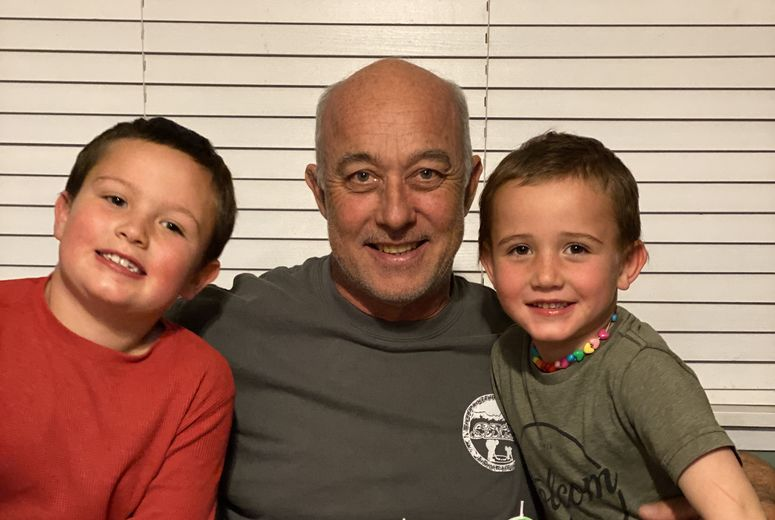 Jeff Aukee and his grandsons celebrate his 56th birthday with cake