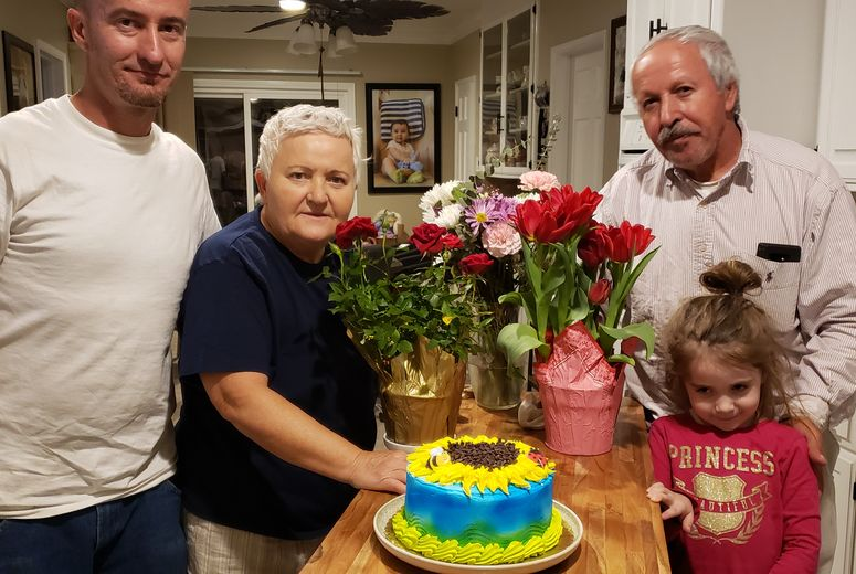 Catinean and her family celebrate a birthday