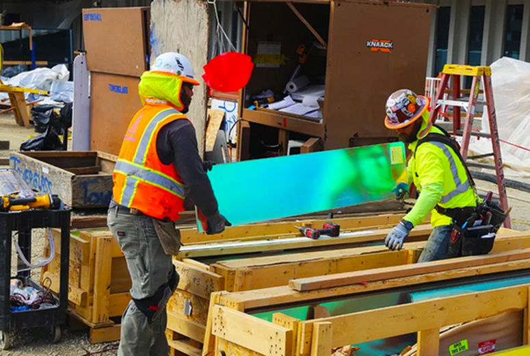 Workers unpack Dichroic glass